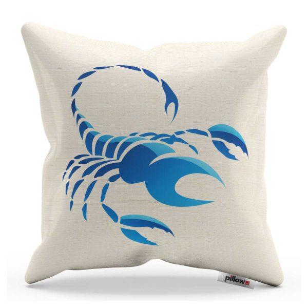 Vankúš bielej farby so znamením škorpión v modrom prevedení